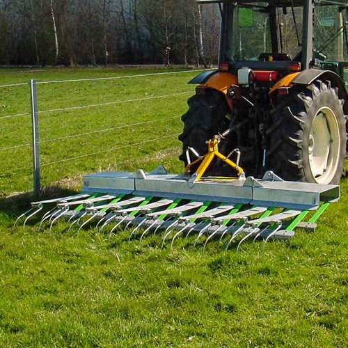 Harrowing dung and aerating the ground
